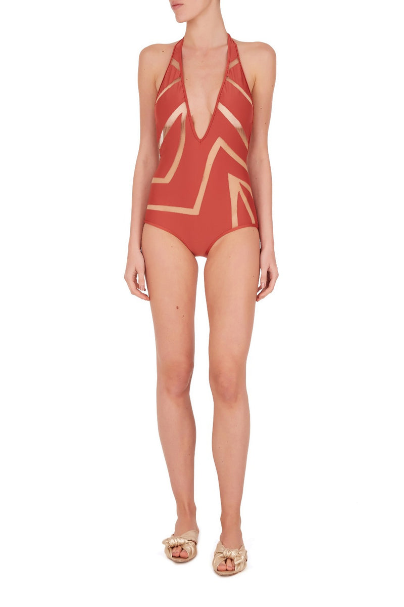 Combining graphism and zebra exotic inspiration, these long triangle tulle hot pants are a must-have piece on your vacation wardrobe