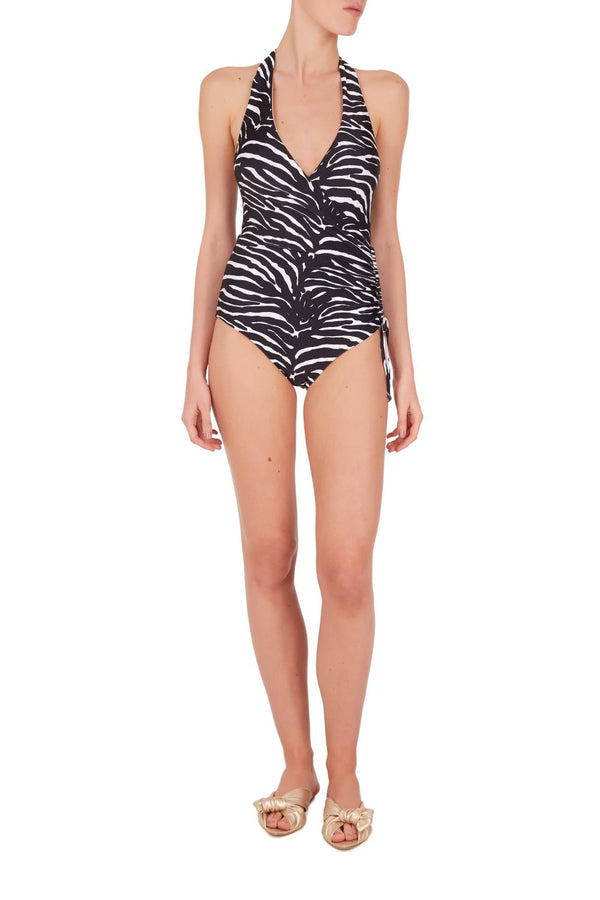 Printed with bold and vintage inspired zebra this swimsuit is cut in a flattering wrap-effect silhouette tha´s accentuated by the slimming ruched side