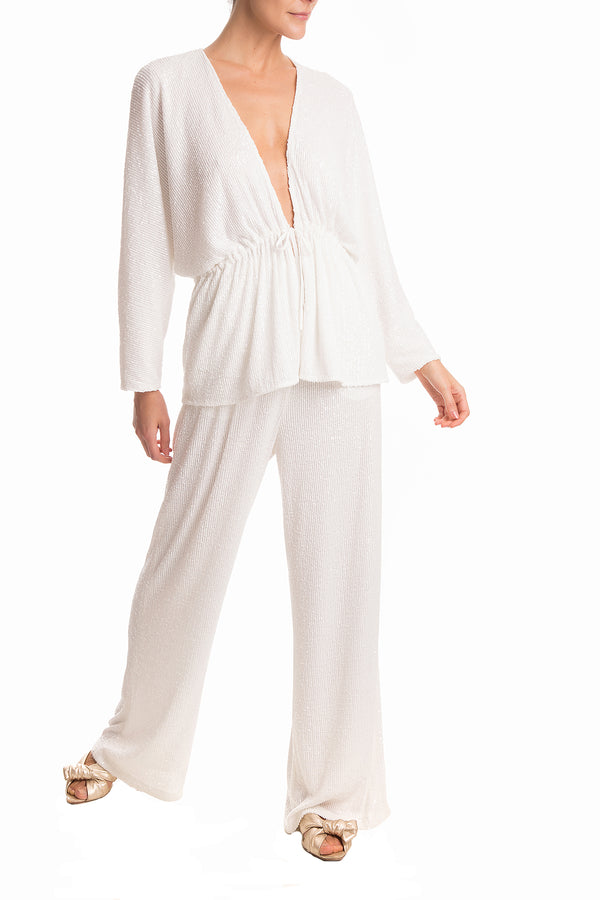 These pants are shaped for a relaxed fit with high-rise waist then fall into wide long legs. Style them with matching shirt for lunch and flat sandals