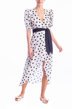This dress is crafted from polka-dot printed silk with an asymmetric skirt and puff sleeves