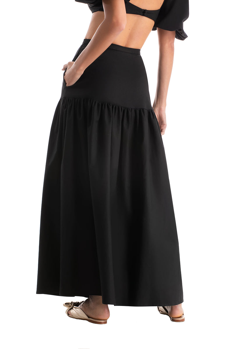 This long skirt is an easy chic piece to be worn after the beach. We love it with a matching swimsuit for drinks with friends poolside on your next getaway
