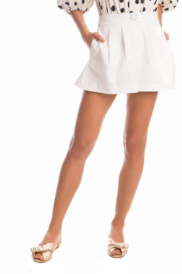 These shorts are made of lightweight fabric and cut to a high-rise waistline and loose-fitting legs