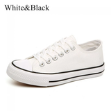 white and black American Style Canvas Sneakers Grab a pair of classic iconic design womens White wear trainers trainer timeless style Sole shoe season rubber sole red Lace jeans iconic global girls girl footwear foot flats Fitting feet fashions fashionable fashion dress designs designer design Day cotton comfortable Colour clothing classical Classic