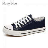 navy American Style Canvas Sneakers Grab a pair of classic iconic design womens White wear trainers trainer timeless style Sole shoe season rubber sole red Lace jeans iconic global girls girl footwear foot flats Fitting feet fashions fashionable fashion dress designs designer design Day cotton comfortable Colour clothing classical Classic