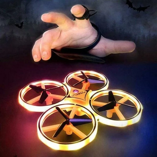 Flying 360° Gesture Control Drone children amazed motion gravity sensor gesture control technology wear the smartwatch sensor detects hand movements throwing smartwatch Sensor's Quadcopter quad off movement move motion kids helicopter hands hand girls girl gift fun flying flyer fly controls control child boys
