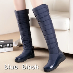 Padded Knee High Boots The hottest trend this season stylish popular down style padding from ankle to knee, winter weather wear warmth trending trend thermal sole shoes shoe legs leggings knees Knee-Length high heels heel footwear feet fashionable fashion fall ease cold clothing calf boot's boot