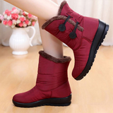 red Women's Snow Boots A excellent pair of adult Designed to keep your feet warm and dry winter weather water resistant Women's womens women womans woman wom weatherproof waterproof warm snowmen snowman Snowing snow shoes mums mum mother Lady ladies ice girls girl foot feet boot's boot