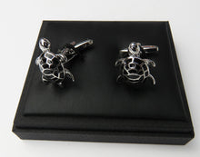 Silver and black turtle shaped cufflink set