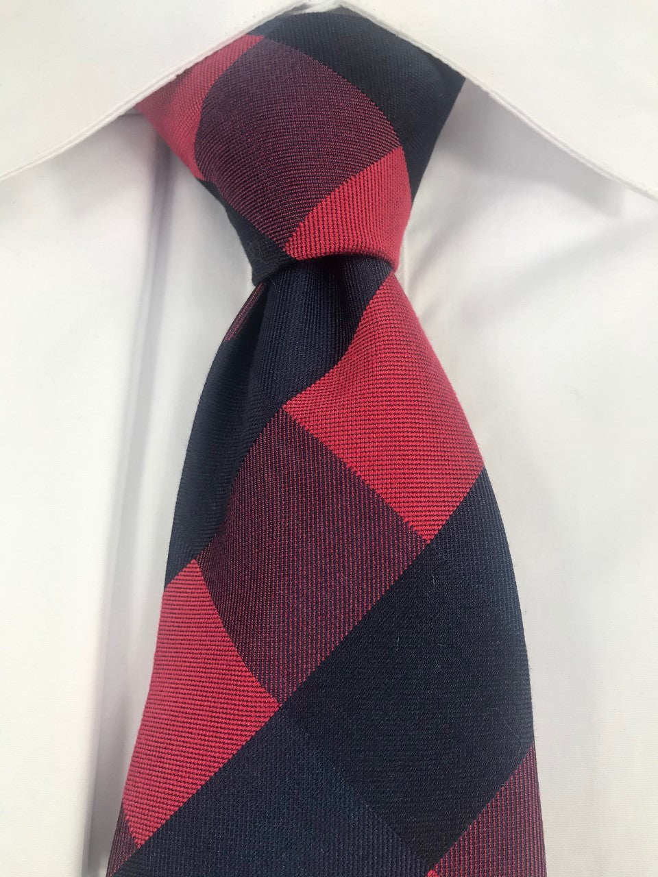 Red and black pattern necktie