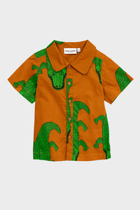 brown short sleeve button through Mini Rodini shirt with crocodile print