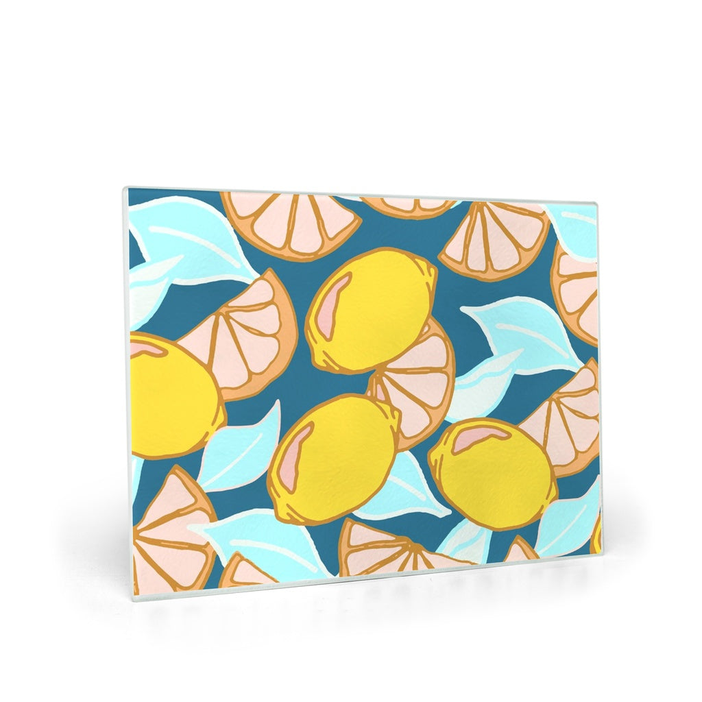 Cutting board hand designed by Jessica Reynolds art. Featuring lemons.