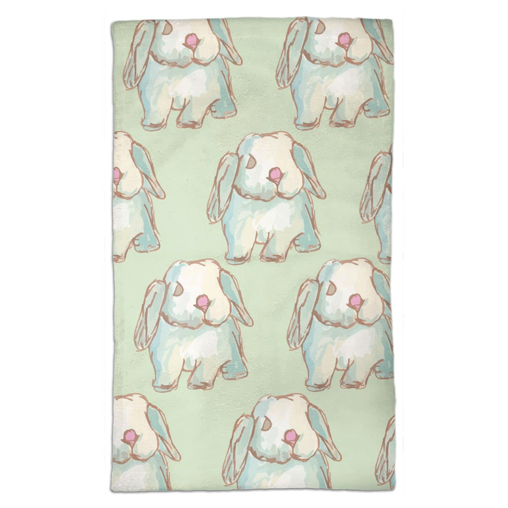 Tea towel hand designed by Jessica Reynolds art. Featuring water color bunnies on a microfiber towel with a terri loop backing.