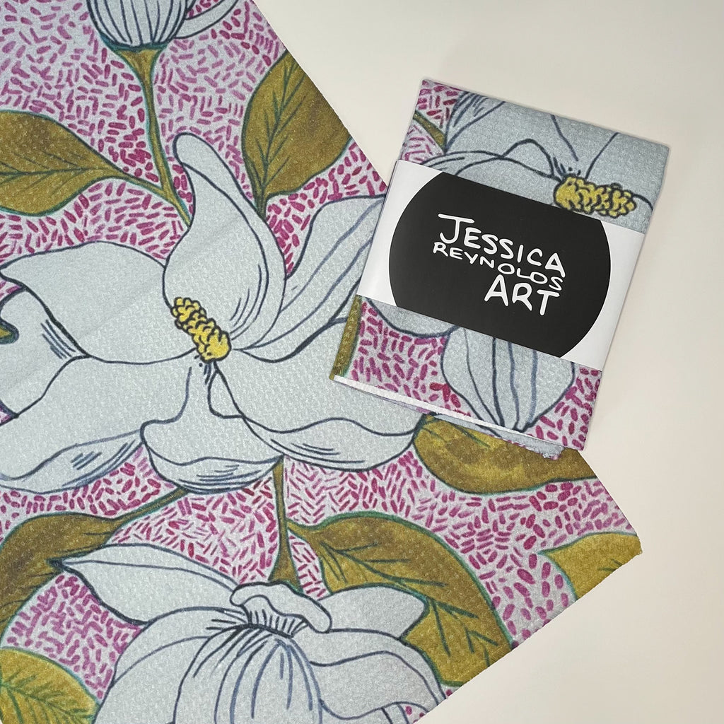 Tea towel hand designed by Jessica Reynolds art. Featuring magnolias on a waffle microfiber towel.