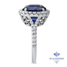 7.86ct Oval Blue Sapphirewith diamond halo in 18K White Gold