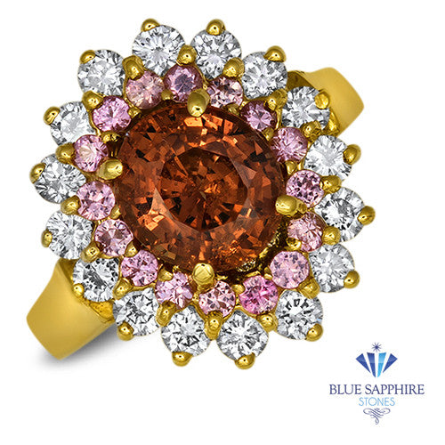 2.55ct Oval Orange Sapphire Ring with Sapphire and Diamond halo in 18K Yellow Gold