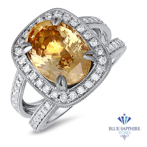 6.58ct Oval Orangy Peach Sapphire with diamond halo in 0