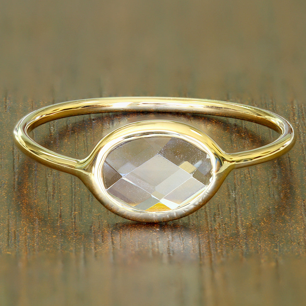1.33ct. Oval White Sapphire Ring in 14K Yellow Gold