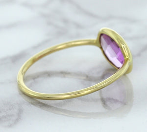 1.45ct. Oval Pink Sapphire Ring in 14K Yellow Gold