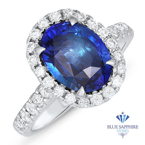 3.68ct. Oval Blue Sapphire Ring with Diamond Halo in 18K White Gold
