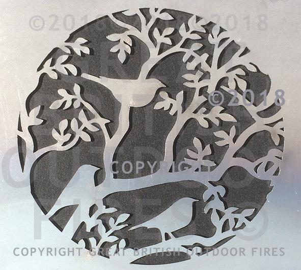 """This circluar design shows three blackbirds perched among the branches and leaves of a tree. """