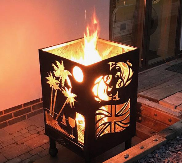 """This is a photo of a fire pit which displays the Pisces Pictorial zodiac sign, amongst other designs."""