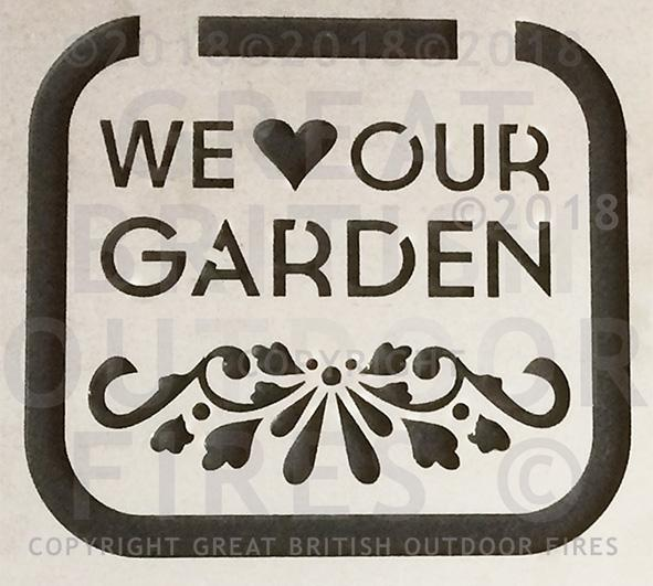 """This design is the phrase 'We Love Our Garden' (the word love is a heart symbol). It has a floral pattern along the bottom."""