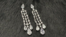 Load and play video in Gallery viewer, CASCADIA - Slim Chandelier With Triple Teardrop Earrings In Silver