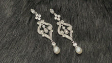 Load and play video in Gallery viewer, IMOGEN - Art Deco Style Scrolled Pave And Pearl Drop Earrings In Silver