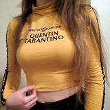 Written and directed by Quentin Tarantino turtle neck crop top