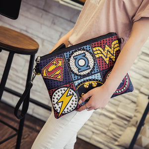 Superhero studded logo clutch wristlet - Iconic Trendz Boutique