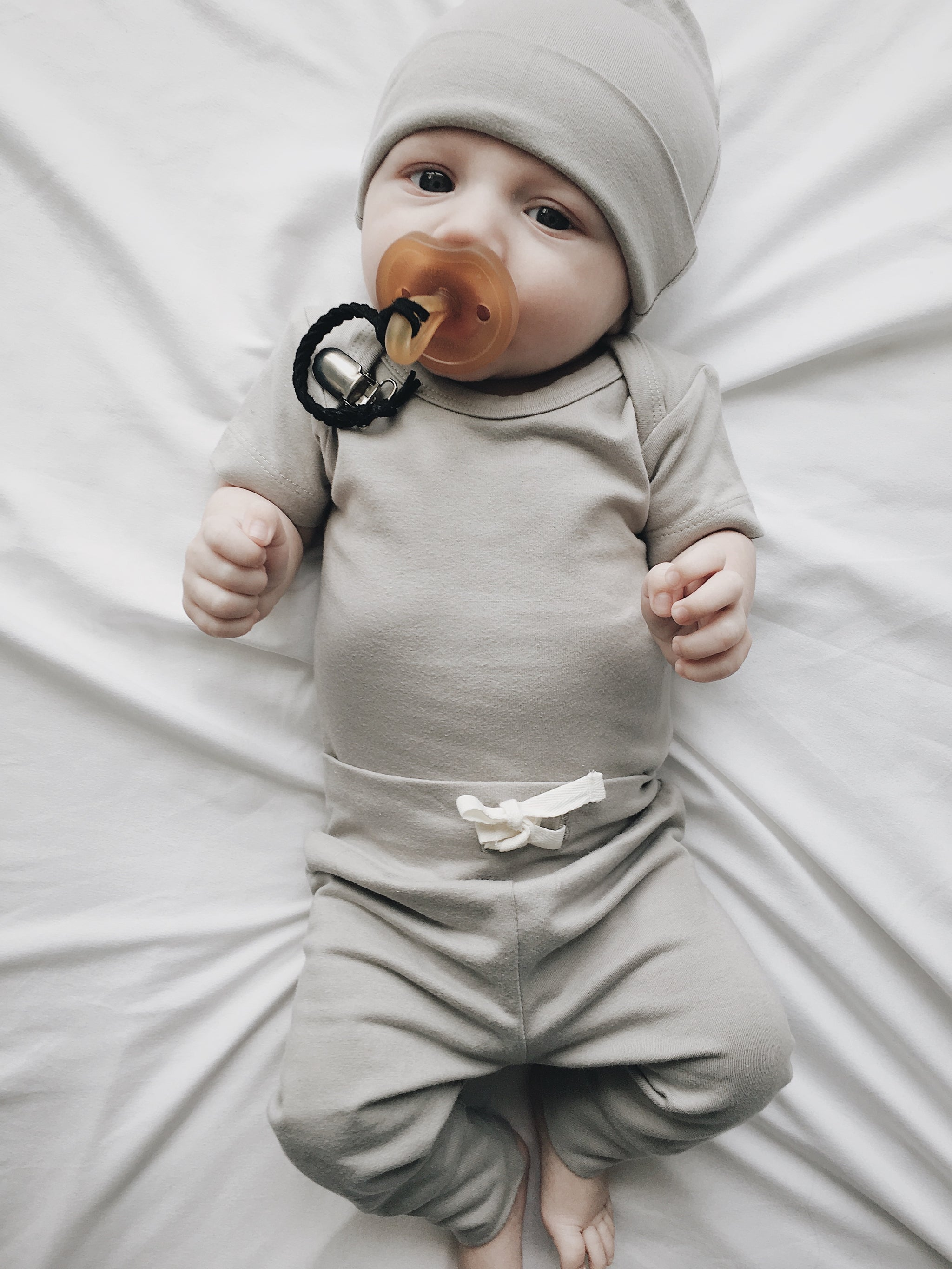 Lucy Lue Organics. Ivory organic bodysuit. Organic baby clothes. Organic newborn outfit. Organic cotton. Organic kids clothes. Organic baby fashion. Ethical clothing. Gender neutral colors. Minimalist modern baby style. Organic Baby products.