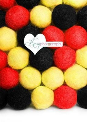 Kate Mouse Red Yellow and Black Pom Pom Ball Wall Backdrop Designed by Kerry Anderson