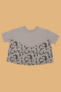 Girls grey A line shaped shirt with puzzle print
