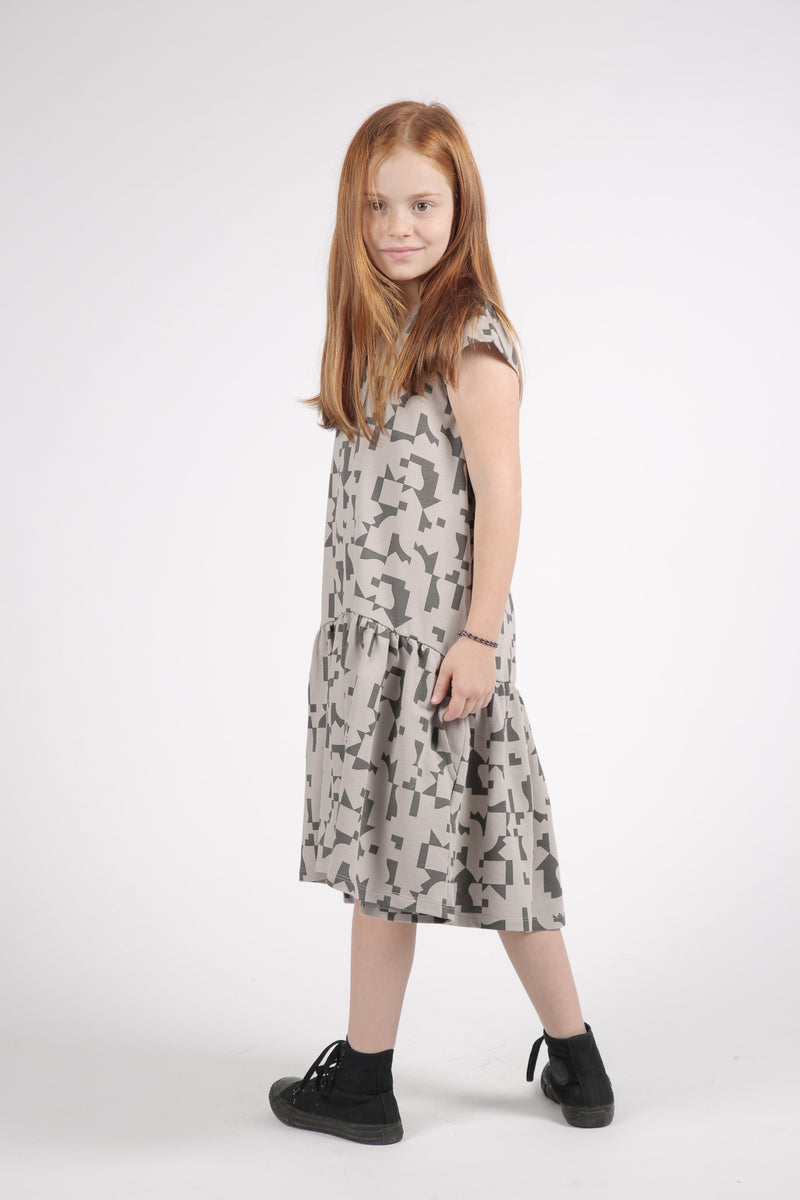 Girls grey drop waist dress with puzzle print