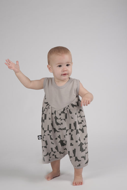 Grey puffy romper with puzzle print