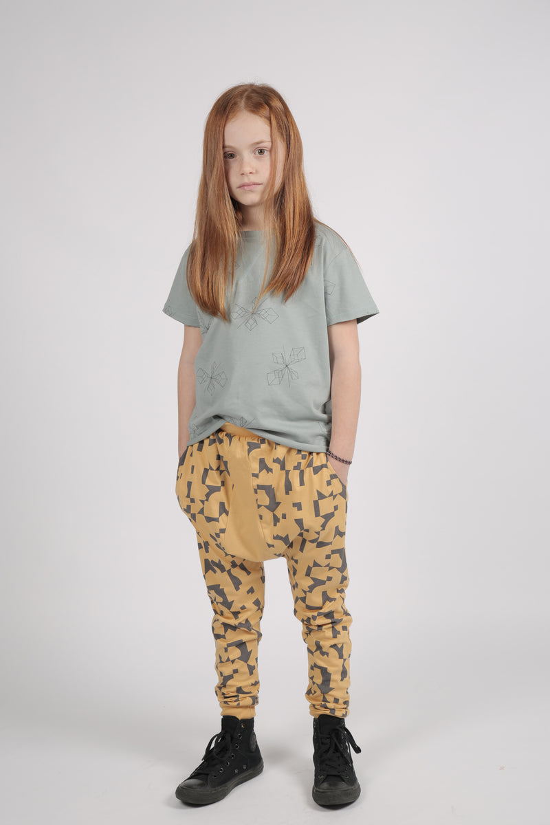 Kids mustard triangle harem pants with puzzle print