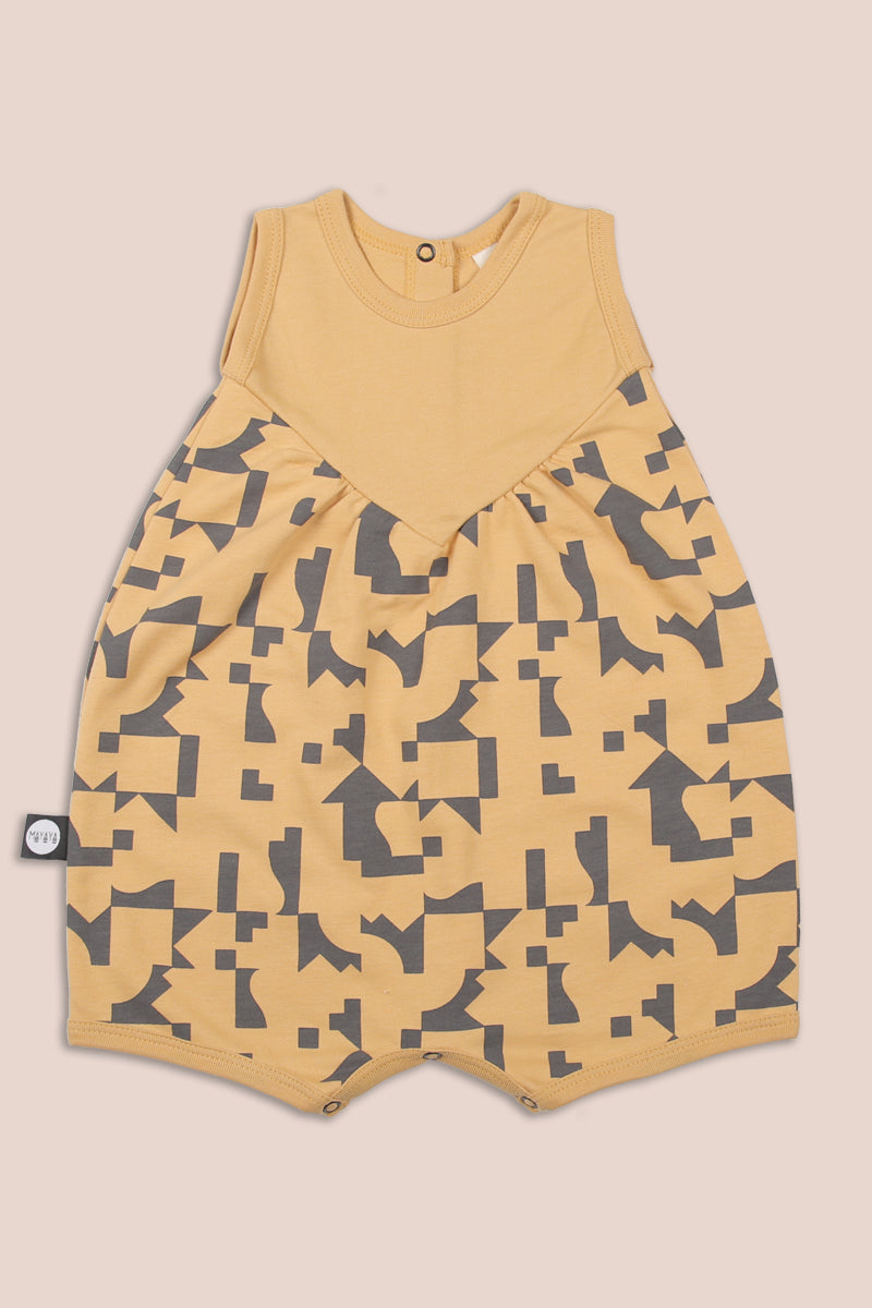 Mustard puffy romper with puzzle print