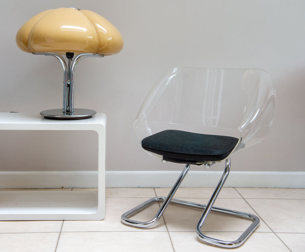 Guzzini Armchair in metal and acrylic by Harvey GUZZINI from 1968. Legs in chromed metal. Shell in acrylic. Seat in black upholstery. In good vintage condition. This is the smaller version 'ART 6004' Rarely available.