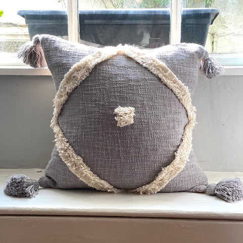 grey pom pom cushion
