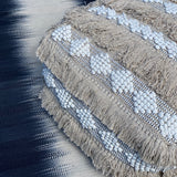 fringed floor cushion