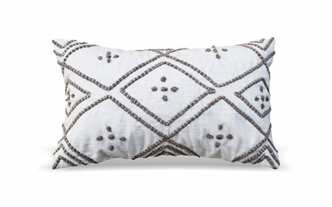 white and grey stitched pillow