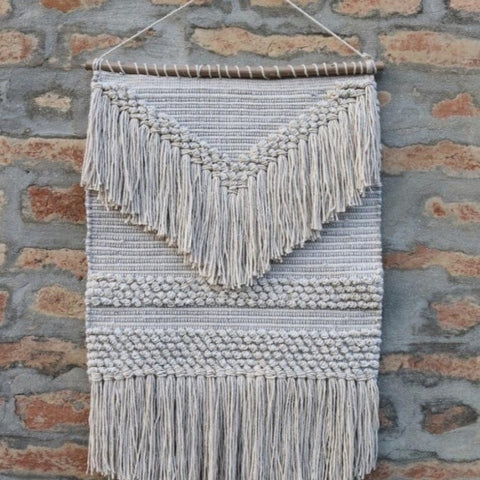 grey white woven wall hanging