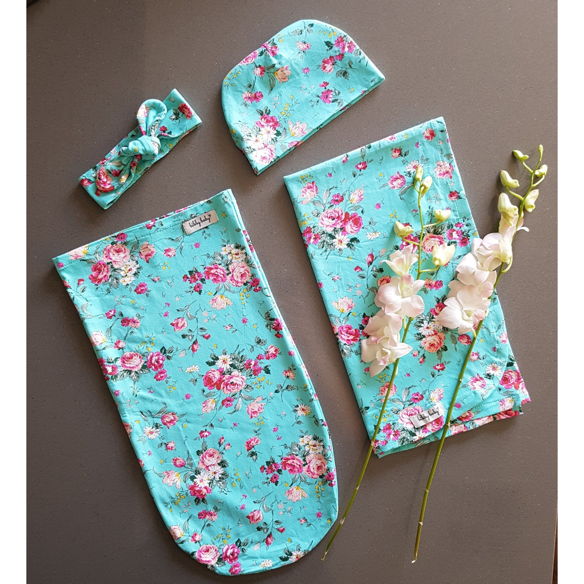 Baby Bundle I Swaddle Sack with matching Beanie, Topknot & Wrap - Mint Floral