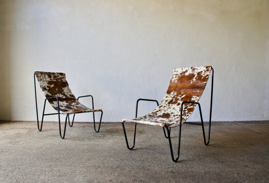 PAIR OF 1950'S COWHIDE SLING CHAIRS