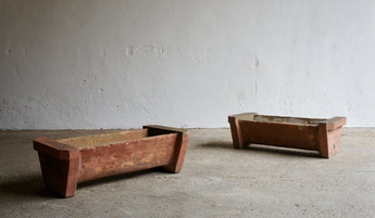 PAIR OF MODERNIST CONCRETE PLANTERS