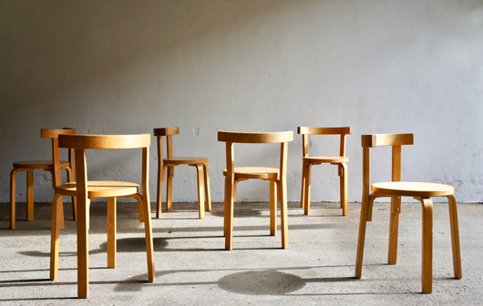 A SET OF 6 BENT PLYWOOD CHAIRS