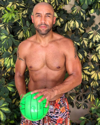 Alex Beresford topless with ball and swim shorts