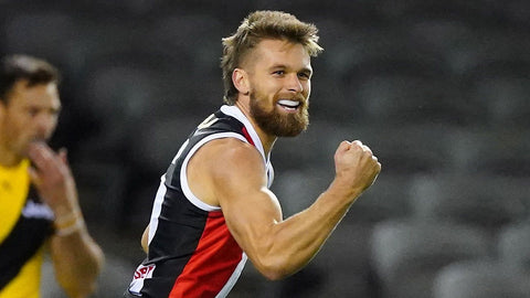 Dan Butler with beard and red blue top no sleeves