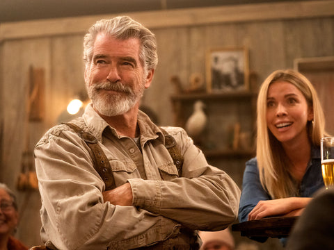 Pierce Brosnan with beard and blond woman