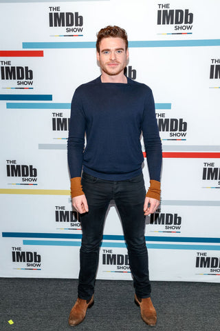 Richard Madden shows his toned body in tight jeans and a jumper